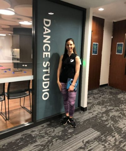 Miss Issy standing in front of her new dance studio