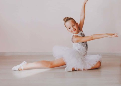 Young Ballerina posing in white